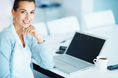 Buy stock photo Woman working at desk with laptop, cell phone and coffee near by