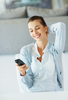 Buy stock photo Woman smiling and stretching while holding phone