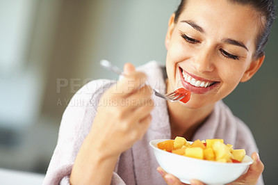 Buy stock photo Attractive woman eating bowl of fruit