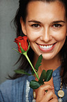 Happy woman holding red rose