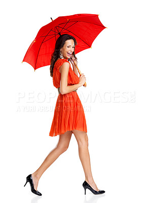 Buy stock photo Portrait of beautiful young female walking with umbrella on white background