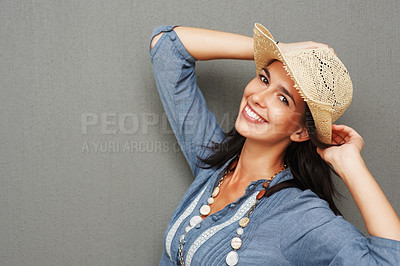 Buy stock photo Attractive woman tilting her head while holding hat