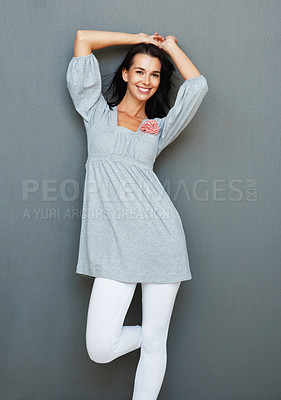 Buy stock photo Pretty smiling woman posing against wall