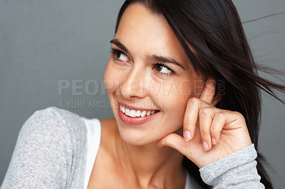 Buy stock photo Closeup of woman resting face on hand and looking to the side