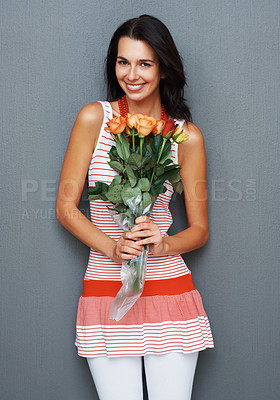 Buy stock photo Woman smiling while holding bouquet of roses