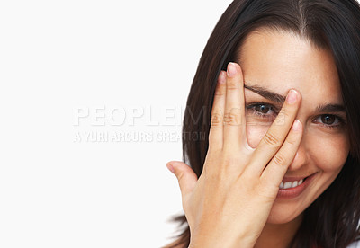 Buy stock photo Closeup of woman peeking between fingers