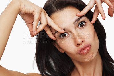 Buy stock photo Woman holding up fingers on face and making silly expression