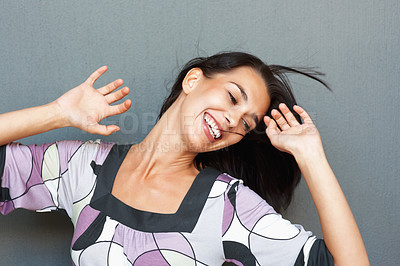 Buy stock photo Woman smiling while dancing