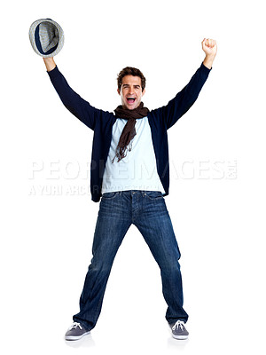 Buy stock photo Portrait of excited young man holding a hat celebrating success on white background