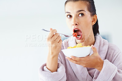 Buy stock photo Portrait of pretty young woman eating fruit salad - copyspace
