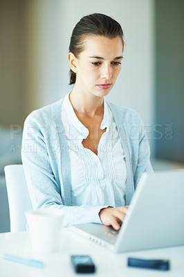 Buy stock photo Portrait of young business woman busy working on laptop
