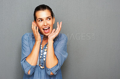 Buy stock photo Surprised young woman looking at copyspace