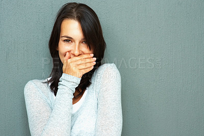 Buy stock photo Portrait of pretty young woman with hand over mouth against the wall