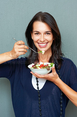 Buy stock photo Portrait of charming young woman eating fruits salad against wall