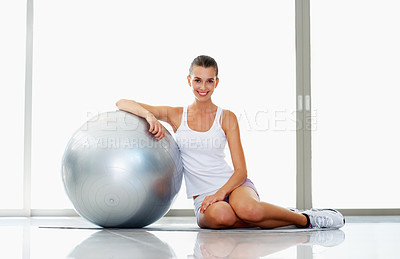 Buy stock photo Portrait of smiling young woman posing with fitness ball