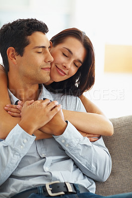 Buy stock photo Pretty young woman embracing her boyfriend from behind