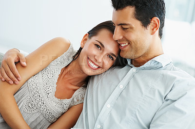 Buy stock photo Portrait of affectionate young couple smiling together