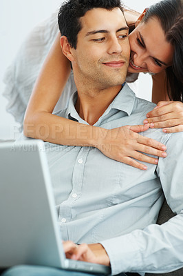 Buy stock photo Portrait of happy young couple with laptop smiling