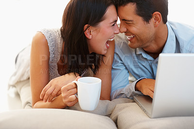 Buy stock photo Playful young couple with coffee cup and laptop