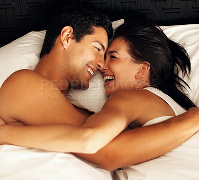 Buy stock photo Top view of playful young couple enjoying in bed