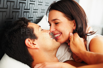 Buy stock photo Closeup of young couple sharing romantic moment