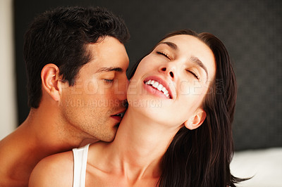 Buy stock photo Romantic young man kissing woman on neck