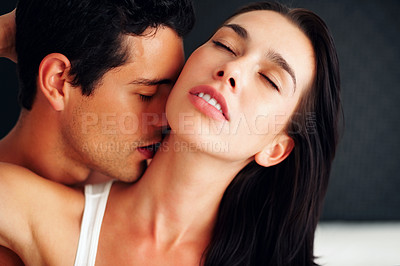 Buy stock photo Closeup of young man kissing girlfriend on her neck