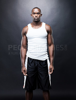 Buy stock photo Portrait of a muscular young man standing against grunge background