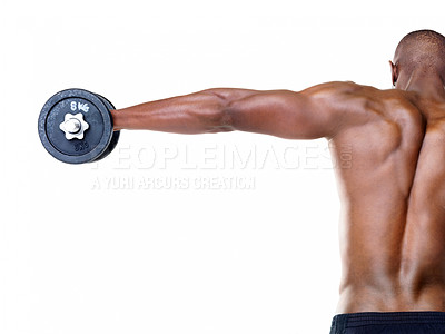 Buy stock photo Rear view of an African American man with outstretched arm holding a weight against white background - copyspace