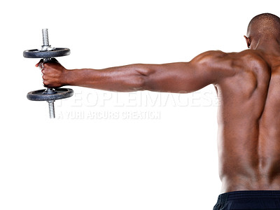 Buy stock photo Rear view of a healthy young man doing shoulder exercise with dumbbell against white background