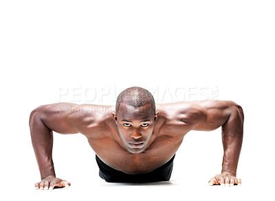 Buy stock photo Portrait of a muscular young man doing push ups exercise against white background