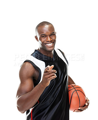 Buy stock photo Portrait of a happy young male basketball player pointing at you against white background