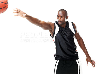 Buy stock photo Portrait of a young male basketball player passing the ball while isolated on white background