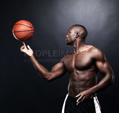 Buy stock photo Portrait of a fit afroamerican man playing with a basketball against grunge background