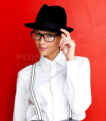 Buy stock photo Portrait of a pretty young girl wearing hat and glasses against red background