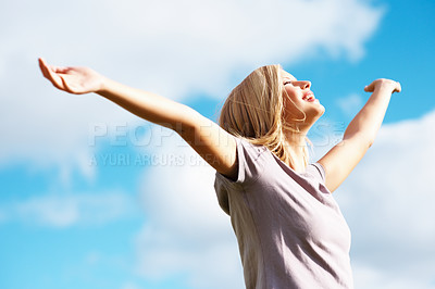 Buy stock photo Young pretty female with arms out spread standing outdoors