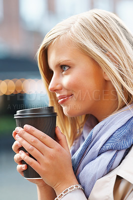 Buy stock photo Side view of pretty young woman drinking coffee
