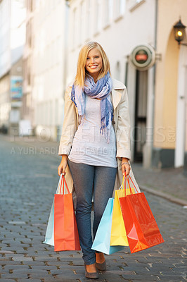 Buy stock photo Full length of happy young woman with shopping bags