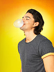 Attractive man blowing bubble