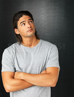 Buy stock photo Man with arms crossed looking at copyspace against gray background