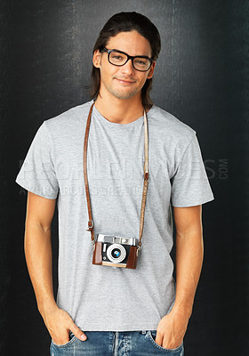 Buy stock photo Man wearing glasses and vintage camera around neck