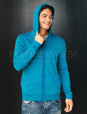 Buy stock photo Handsome man pulling on hood of sweatshirt while looking into distance