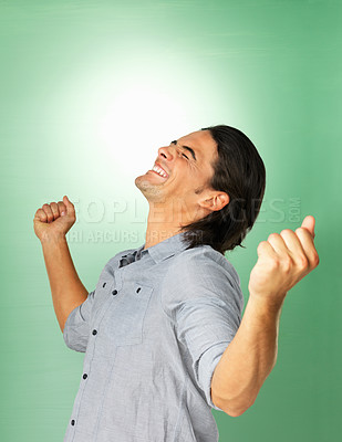Buy stock photo Man smiling and looking up while clenching fists