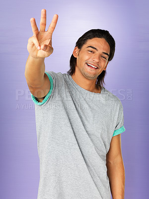Buy stock photo Handsome man holding up three fingers