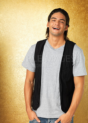 Buy stock photo Man standing and smiling against gold background