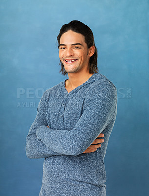 Buy stock photo Handsome man with arms folded against blue background