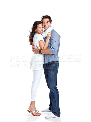 Buy stock photo Portrait of happy young couple embracing each other against white background