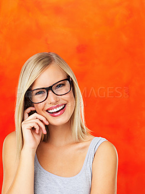 Buy stock photo Closeup of pretty smiling woman in glasses on orange background