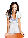 Pretty young fashion model smiling on white