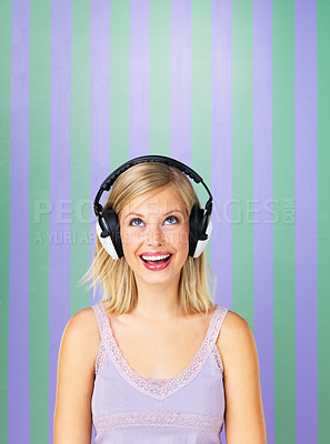 Buy stock photo Pretty woman looking up while listening to headphones